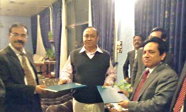 Bashundhara Group Chairman Ahmed Akbar Sobhan exchanges documents with MA Quader Sarker, secretary of Rural Development and Cooperatives ministry and also president of BCS (Taxes) Officers' Welfare Multipurpose Cooperative Society, after the signing of a memorandum of understanding (MoU) at the chairman's office at Bashundhara residential area in the city on Thursday. East West Property Development Ltd (EWPDL), an enterprise of Bashundhara Group, will complete a housing project for the society with civic amenities.