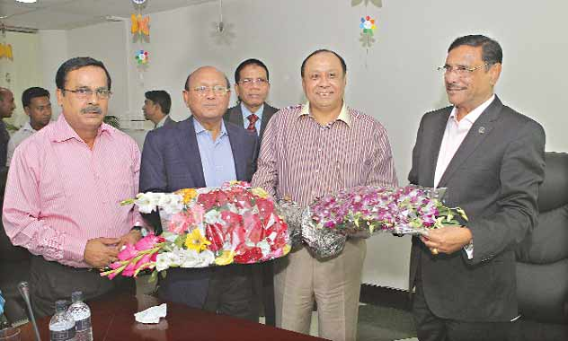 Commerce Minister Tofail Ahmed and Communications Minister Obaidul Quader present bouquets to Ahmed Akbar Sobhan, chairman of the East-West Media Group Ltd, on the occasion of the 4th anniversary of publication of Bangladesh Pratidin at EWMGL conference room in Bashundhara residential area in the city on Saturday.